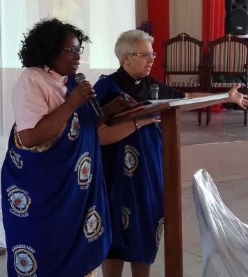 Cynthia speaking with the Rev. Dr. Faith Lugazia translating.