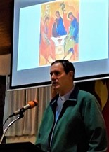 Mark preaching on Trinity Sunday, with the Rublev icon behind.